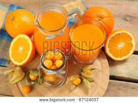 sweet orange juice on wooden table