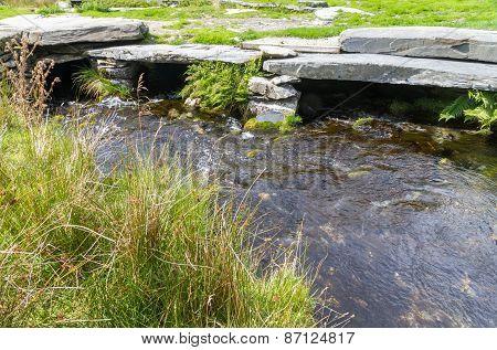 Stream Flowing Under Clapper Bridge.