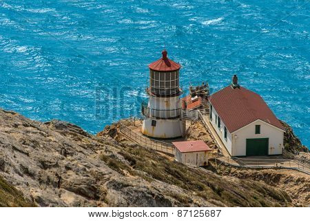 Point Reyes Lighthouse On Cliff By Pacific Ocean