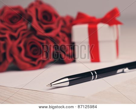 blank greeting  card with flowers and gift