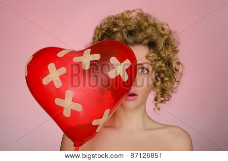 Unhappy Woman With Ball In Shape Of Heart