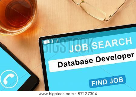 Tablet with Database Developer on  job search site.