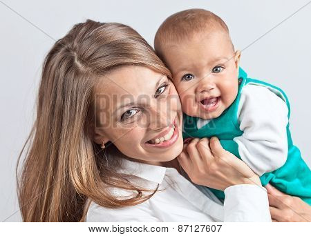 Happy Mum With The Baby
