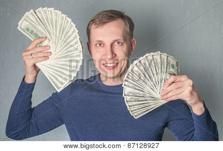 Greedy Man Displaying A Spread Of Dollars