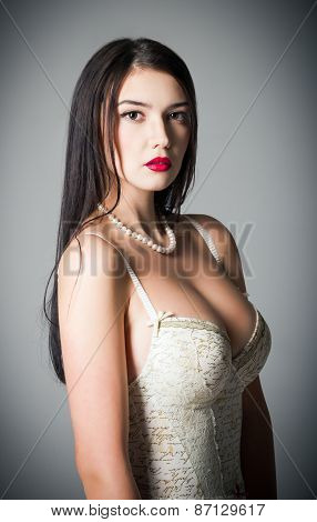 Studio Fashion Shot: Beautiful Woman Wearing Body And Necklace