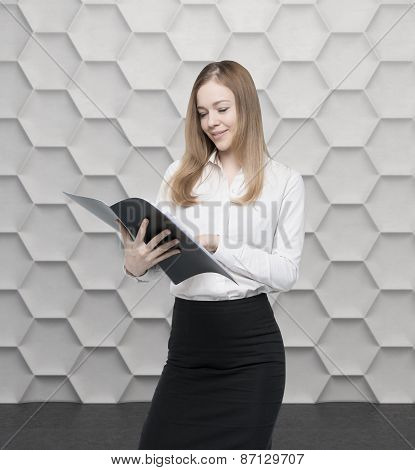 Young Business Lady Is Looking At The File. Contemporary Background.