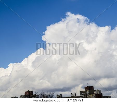 White Clouds Flying Over City