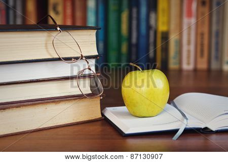 apple on the open book