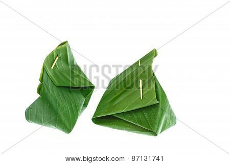 Sticky Rice With Steamed Custard, Wrapped In Banana Leaves
