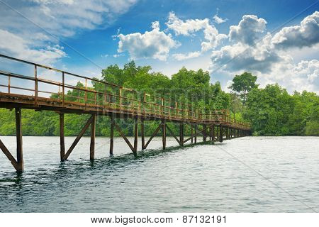 Wooden bridge over the lake
