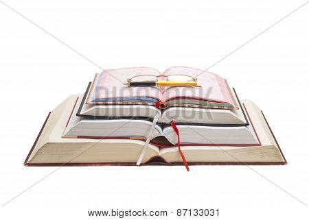 Book, Pen And Glasses In A Single Composition.
