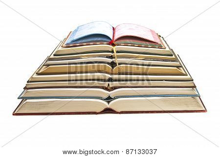 Books Stacked On White Background.