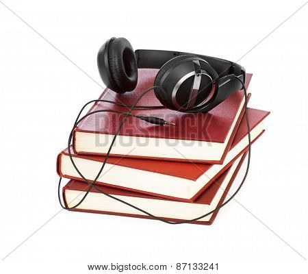 Headphones and books isolated on white background