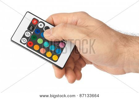Remote control for change colors in hand isolated on white background