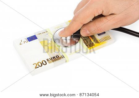 Hand with stethoscope and money isolated on white background