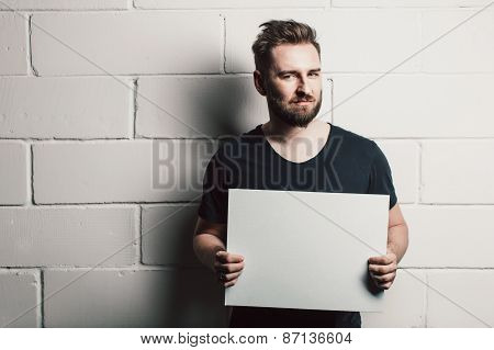 Man With Beard Showing Blank White Card