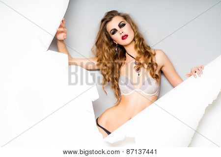 Woman Tearing Paper Background