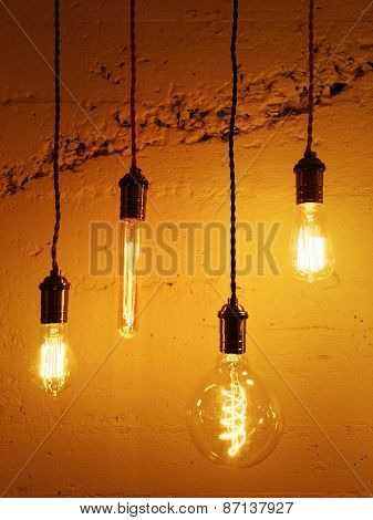 Light Bulbs On Concrete Background