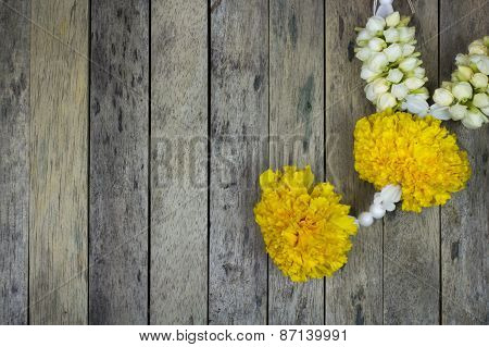 Marigold Flower Garland On Wood Plank, Top View