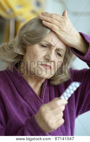 Senior woman with pills