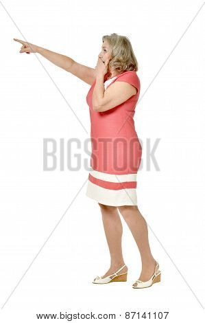 Senior woman in dress pointing