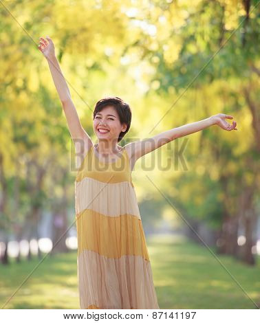 Portrait Of Beautiful Young Asian Woman Feeling Free With Relaxing Toothy Smile And Happy Emotion In