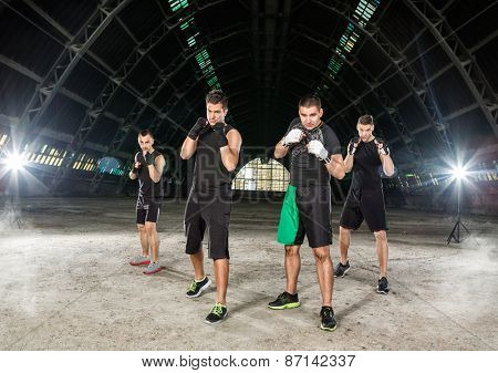 group of young men on kick box training