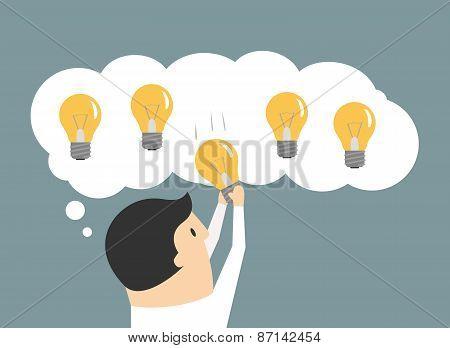 Businessman choosing the best idea light bulb