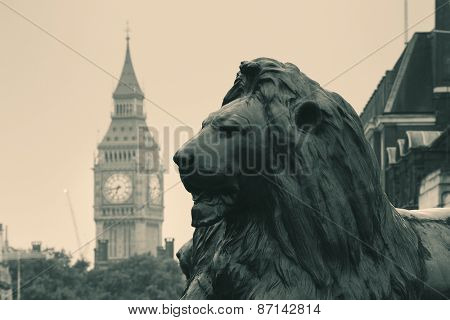 Trafalgar Square lion statue and Big Ben in London in BW