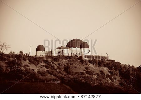 Griffith Observatory over mountain in BW in Los Angeles.