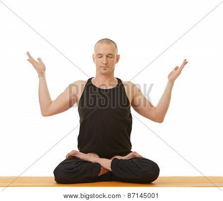 Image of meditator man posing in lotus position