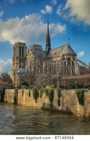 PARIS, FRANCE, MARCH 02 2015: Notre Dame de Paris along the la Seine river in Paris, France.