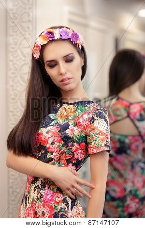 Beautiful Girl Trying on Floral Dress