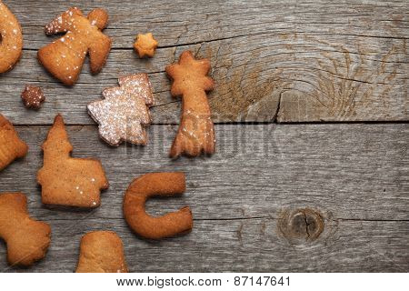 Various gingerbread cookies on wooden table background with copy space