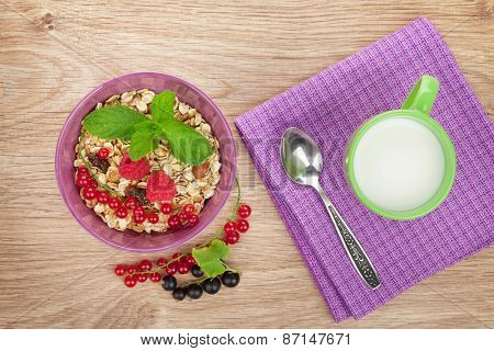Healthy breakfast with muesli and milk. View from above on wooden table