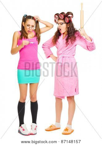Angry mother and worried daughter with pregnancy test isolated