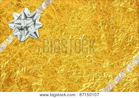 Shiny Yellow Leaf Gold And  Silver Ribbon On Shiny Foil Texture Background