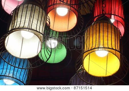 Purple, Green, Yellow, White, Red And Orange Round Stylish Lampshades Hang From Ceiling