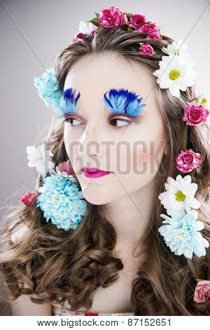 Beautiful Girl With Creative Make-up And Hairstyle With Flowers
