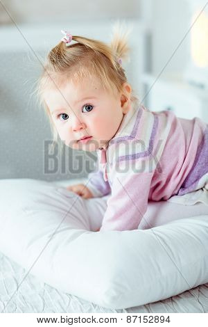 Adorable Blond Little Girl With Big Grey Eyes And Plump Cheeks Staying On Hands And Knees On bed