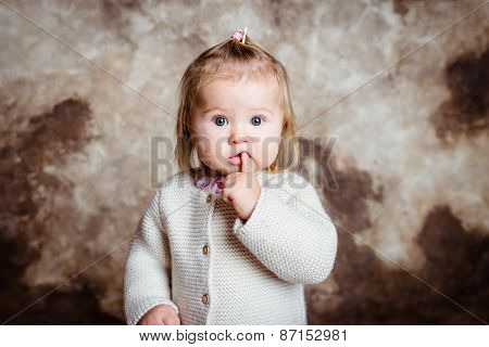Close-up Portrait Of Cute Blond Little Girl With Big Grey Eyes And Plump Cheeks