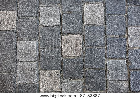 Granite cobble stone pavement background texture.