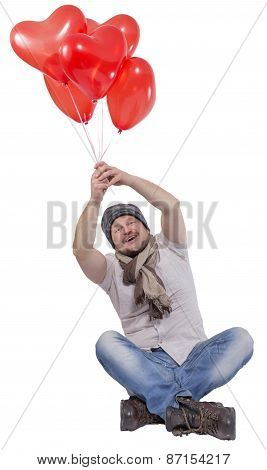 Young man flying on balloons on white background