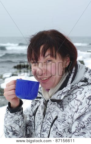 Woman Is Drinking Hot Tea