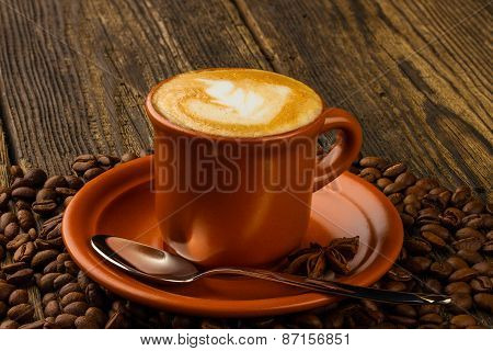 Cup Of Cappuccino, Star Anise And Coffee Beans
