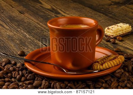 Cup Of Coffee, Sweet And Coffee Beans