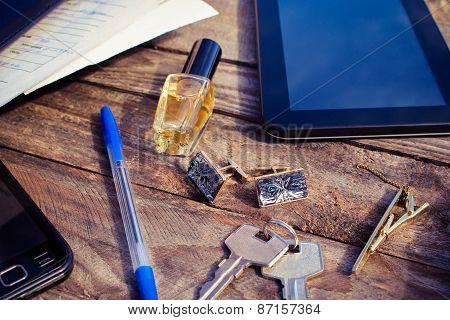 Men accessories: cufflinks, tablet, perfume, pen, mobile phone, headphones, folder of documents