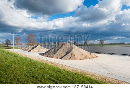 River Quay With Heaps Of Sand And Gravel