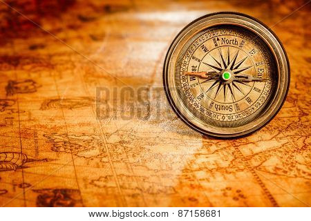 Vintage still life. Vintage compass lies on an ancient world map in 1565.
