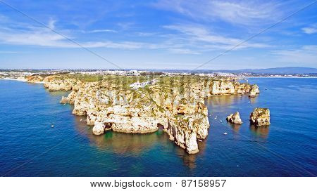 Aerial from Ponta Piedade with the lighthouse in Lagos Portugal